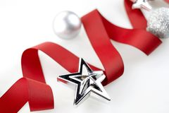 Christmas red ribbon decorate with silver glitter ornament balls. And star on white background stock photo