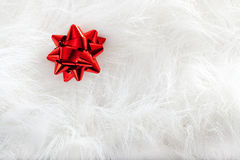 Christmas red ribbon look over white fur Royalty Free Stock Photography