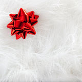 Christmas red ribbon look over white fur Royalty Free Stock Photos