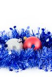 Christmas red and silver balls in blue tinsel. Christmas red and silver balls in an environment of a blue tinsel vertical frame royalty free stock images