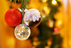 Christmas red and silver baubles. Celebrating magic night of Christmas with red, silver and mirrors baubles. Over defocused Christmas tree and fairy lights royalty free stock photography