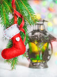 Christmas red sock on fir branch and lantern Stock Images