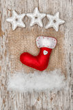 Christmas red sock with snow on burlap textile Stock Photography