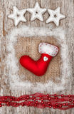 Christmas red sock with snow on burlap textile Royalty Free Stock Images
