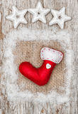 Christmas red sock with snow on burlap textile Royalty Free Stock Photos