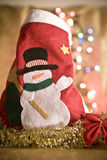 Christmas red sock with snow man. And golden tinsel stock photos