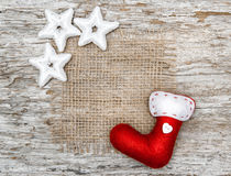 Christmas red sock with stars on burlap textile Stock Photo