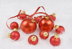 Christmas red spheres. On the white fur Royalty Free Stock Photos