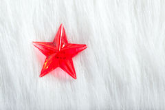 Christmas red star over winter white fur Royalty Free Stock Images