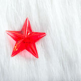Christmas red star over winter white fur Stock Photography