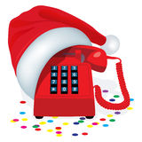 Christmas Red Stationary Phone With Button Keypad In Cap Of Santa Claus. Royalty Free Stock Photos