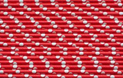 Christmas red straws as background. Top view. Royalty Free Stock Photo