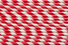 Christmas red straws as background. Top view. Pattern. Stock Photo