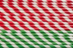 Christmas red straws as background. Top view. Pattern. Stock Photos