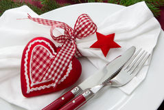 Christmas - red table setting - knife and fork. Close up of elegant red table setting - knife and fork for christmas Royalty Free Stock Photography