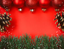 Christmas red textured paper background, balls decor Royalty Free Stock Image