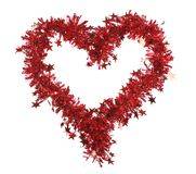 Christmas red tinsel with stars as heart. Stock Photos