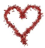 Christmas red tinsel with stars as heart. Royalty Free Stock Images