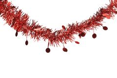 Christmas red tinsel with stars. Stock Photos