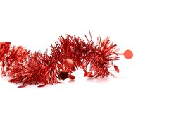 Christmas red tinsel with stars. Royalty Free Stock Photo
