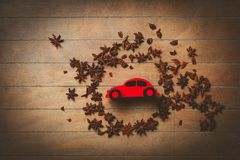 Christmas red toy car and star anise. On wodoen backgorund royalty free stock photos