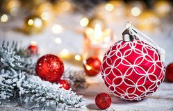 Golden christmas star with fir branch. Golden christmas star with candle, fir branch and lights on old wooden table royalty free stock photos