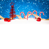 Christmas red tree with candy in snow on blue Stock Image