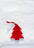 Christmas red tree toys at snow Stock Photo