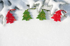 Christmas red tree toys in snow Royalty Free Stock Photos