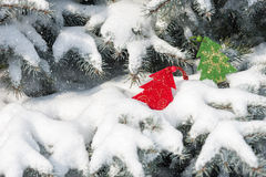 Christmas red tree toys in snowfall Royalty Free Stock Photography