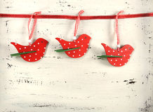 Christmas red and white birds on white vintage wood. Royalty Free Stock Images