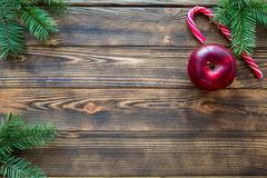 Christmas red and white candy stick and red apples on brown table. Free space for space. stock photo
