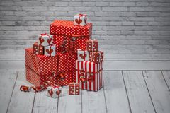 Christmas red and white gifts and box on gray background royalty free stock images