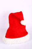 Christmas red and white hat. Red and white christmas hat on white background Royalty Free Stock Photography