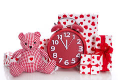 Christmas: red and white presents with clock and pink teddy bea