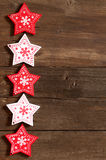 Christmas red and white stars on wooden background Royalty Free Stock Photos