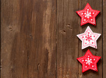 Christmas red and white stars on wooden background Royalty Free Stock Image