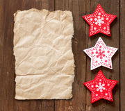 Christmas red and white stars on wooden background Stock Photos