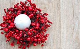 Christmas red wreath. On white wooden background royalty free stock photos