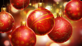Christmas red/yellow abstract background with big decorated red balls at the foreground. Stock Images