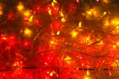 Christmas red and yellow lights border on light wooden background Stock Photos