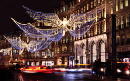 Christmas on Regent Street. London, Regent Street: December 2016 Christmas lights with the Apple Store in the backdrop stock photography