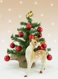 Christmas reindeer. Rudolf reindeer with christmas tree Royalty Free Stock Image