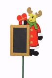 Christmas reindeer board. Christmas reindeer decoration on a stick with a chalkboard space Stock Image