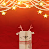 Christmas Reindeer brown paper cut style. On a red crumpled paper texture festive card concept Royalty Free Stock Image