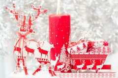 Christmas reindeer and candle composition Royalty Free Stock Images