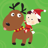 Christmas reindeer and child Stock Images