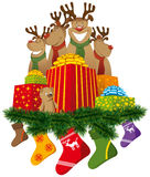 Christmas reindeer with christmas socks and gifts Stock Image