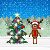 Christmas reindeer and Christmas tree Stock Photography