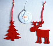 Christmas. Reindeer and Christmas tree isolate on. White stock photo
